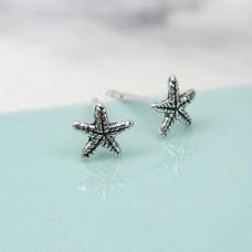 Tiny silver starfish studs
