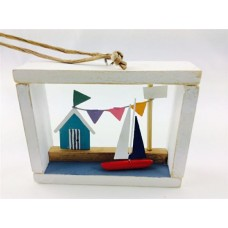 Beachut and sailboat in a framed box