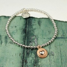 Bead bracelet with silver heart in gold circle