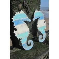 Pair of blue seahorses wall art