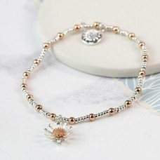 Silver plated and rose gold daisy bracelet
