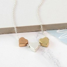 Triple heart mixed finish necklace